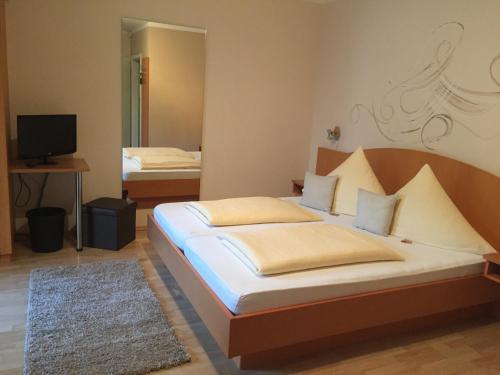 Ein Bett oder Betten in einem Zimmer der Unterkunft Pension Wagner