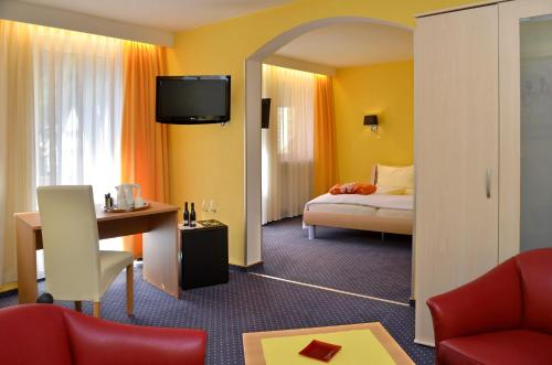 Ein Bett oder Betten in einem Zimmer der Unterkunft Hotel Heissinger