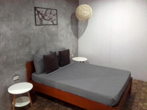 A bed or beds in a room at Alona Pawikan Resort