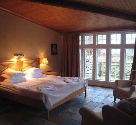 Säng eller sängar i ett rum på Thorskogs Slott