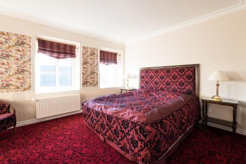 En eller flere senge i et værelse på Den Gamle Grænsekro Inn