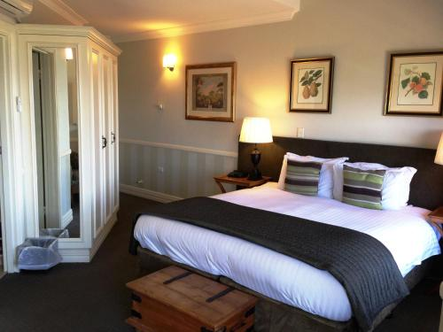 A bed or beds in a room at Echoes Boutique Hotel & Restaurant