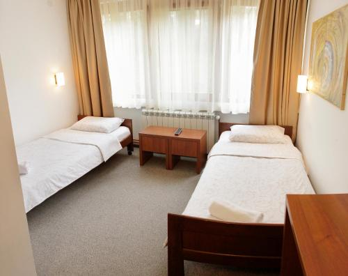 A bed or beds in a room at Hotel Happy