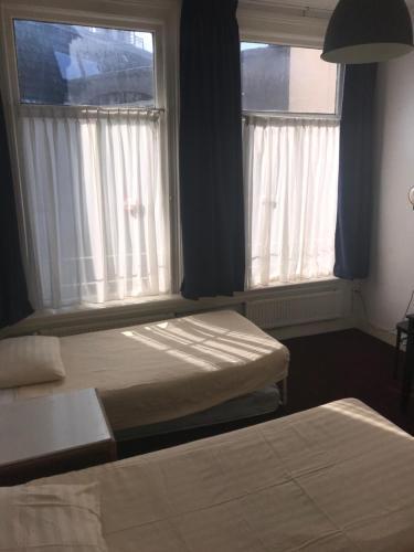 Cama ou camas em um quarto em Hotel Galerij