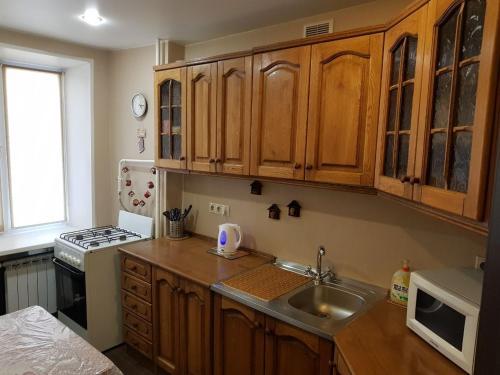 Кухня или мини-кухня в Апартаменты у метро