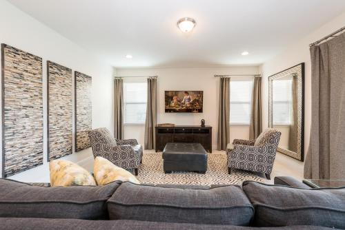 A seating area at Outstanding Home with Water Park Access near Disney - 7731F