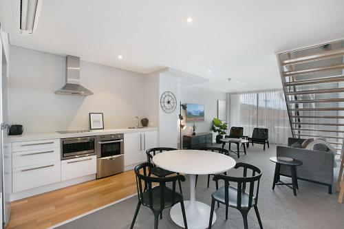 A kitchen or kitchenette at Lure Apartment Nelson Bay - 432