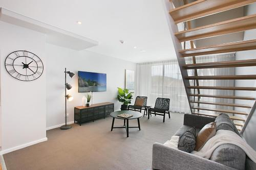 A seating area at Lure Apartment Nelson Bay - 432