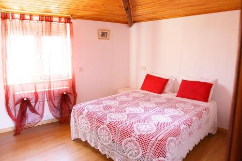 A bed or beds in a room at Casa do Prado