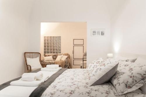 A bed or beds in a room at Ricciarelli 42
