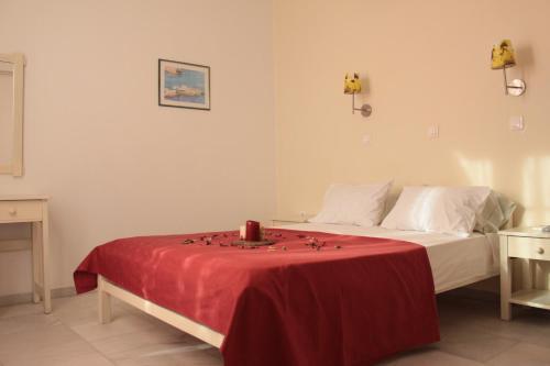 Кровать или кровати в номере Alkion Studios