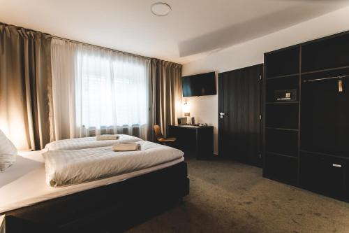 A bed or beds in a room at SILESIA Residence