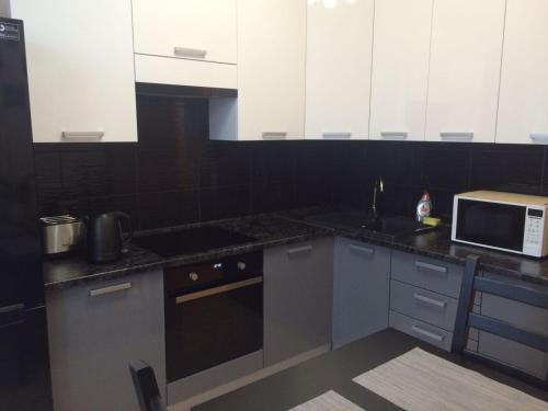 A kitchen or kitchenette at Apartments 1, 2