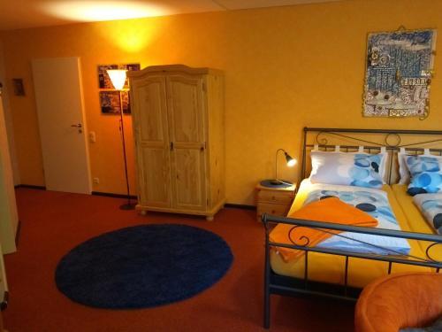 Ein Bett oder Betten in einem Zimmer der Unterkunft Pension Lange