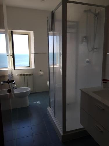 Ein Badezimmer in der Unterkunft Hotel L'Isola