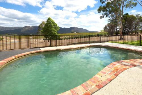 The swimming pool at or near Worthington's Guest Cottage