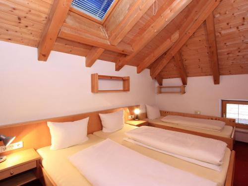 A bed or beds in a room at Ischgl Appartement 7