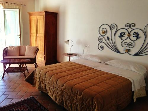A bed or beds in a room at Agriturismo al Colle