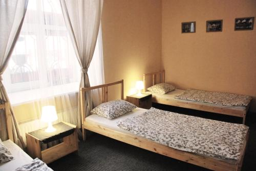 A bed or beds in a room at LikeHome Hostel
