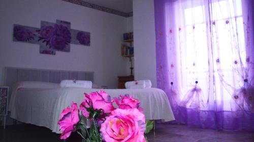 Letto o letti in una camera di B&B Regina Elena