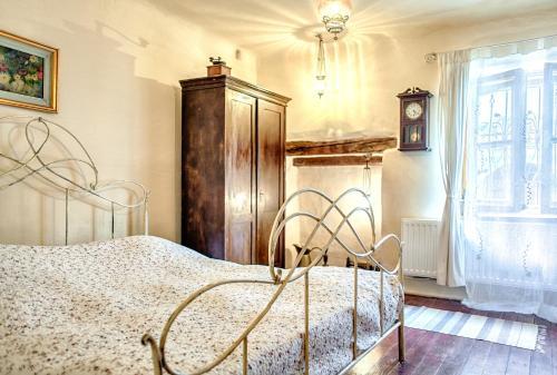 Cama ou camas em um quarto em Dominic Boutique