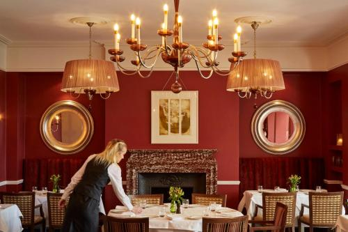 A restaurant or other place to eat at Ockenden Manor Hotel & Spa