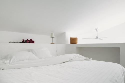 Uma cama ou camas num quarto em Tres Marias