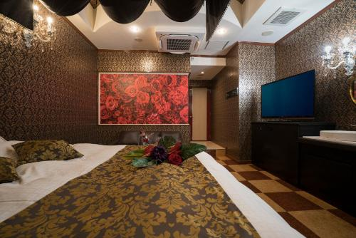 A bed or beds in a room at Gabby Garden (Adult Only)
