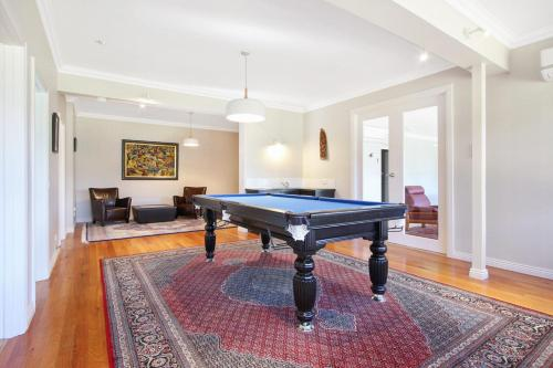 A pool table at River Verse - On the Ovens