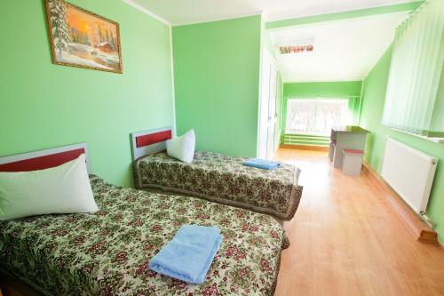 A bed or beds in a room at Pilgrim Hostel