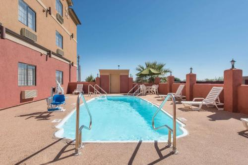 The swimming pool at or near Super 8 by Wyndham Abilene South