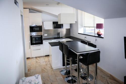 Una cocina o zona de cocina en Penthouse A6 Parque la Carolina/Carolina Park