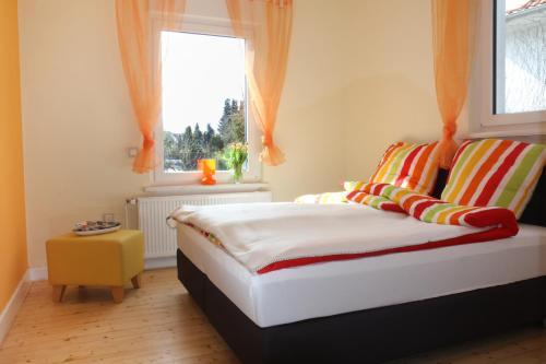 A bed or beds in a room at Tal-Residenz Erdgeschoss