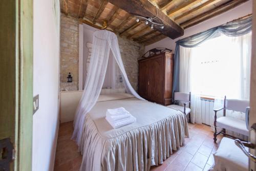 Letto o letti in una camera di Appartamenti turistici Vicolo S. Chiara