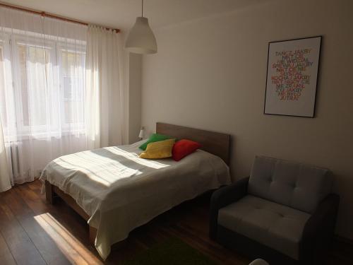 Łóżko lub łóżka w pokoju w obiekcie Apartamenty Uwertura - Apartament 11/11