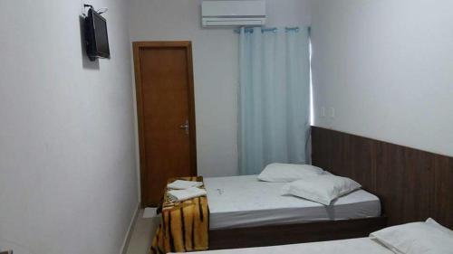 A bed or beds in a room at Hotel Nova Jerusalem