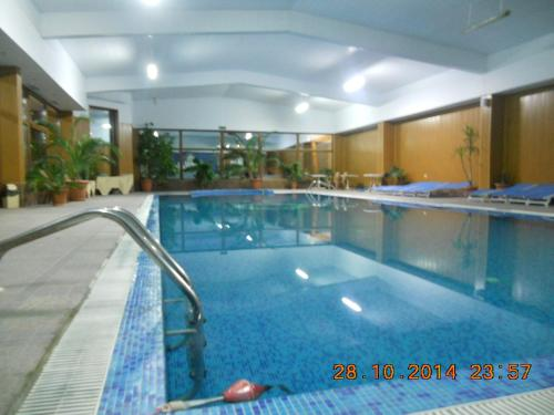 The swimming pool at or near Family Hotel Helios