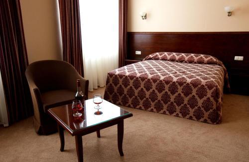 Кровать или кровати в номере CityClub Hotel