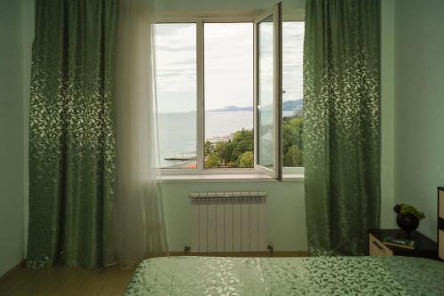 Кровать или кровати в номере Апартаменты на ул. Просвещения 84