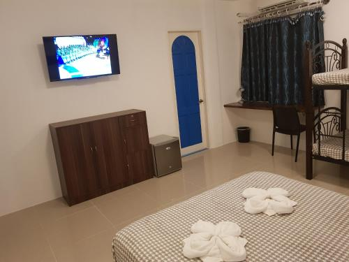 A television and/or entertainment center at D´Gecko Hotel