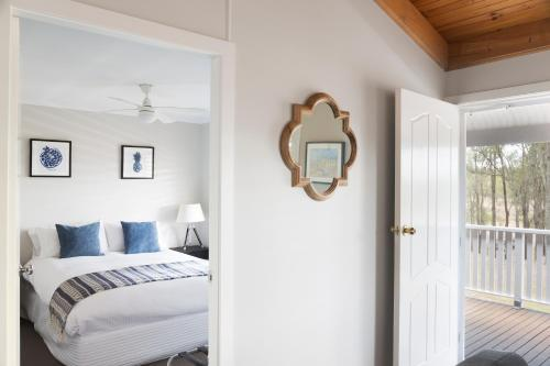 A bed or beds in a room at Worthington's Guest Cottage