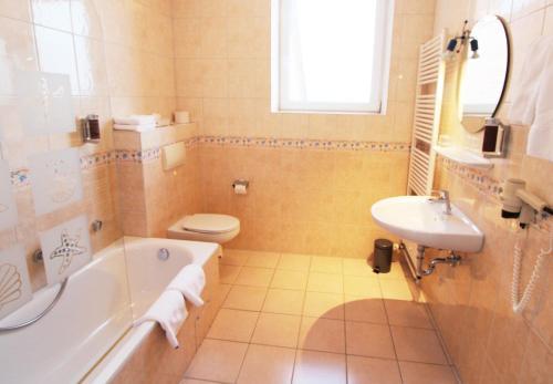 Ein Badezimmer in der Unterkunft Hotel Thormählen