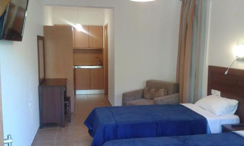 Ένα ή περισσότερα κρεβάτια σε δωμάτιο στο Megalos Mourtias
