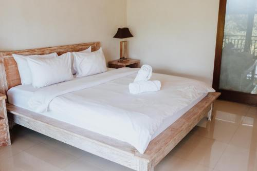 A bed or beds in a room at Matra Bali Surf Camp