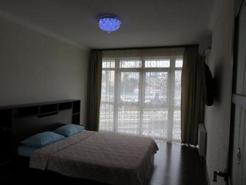 Кровать или кровати в номере Парк Горького