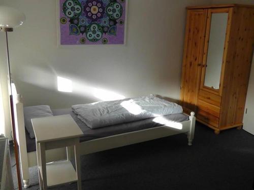 Ein Bett oder Betten in einem Zimmer der Unterkunft CityZimmer Eltmann