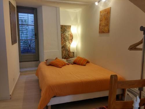 Un ou plusieurs lits dans un hébergement de l'établissement Appartements Cote pont Vieux-Self Check-In