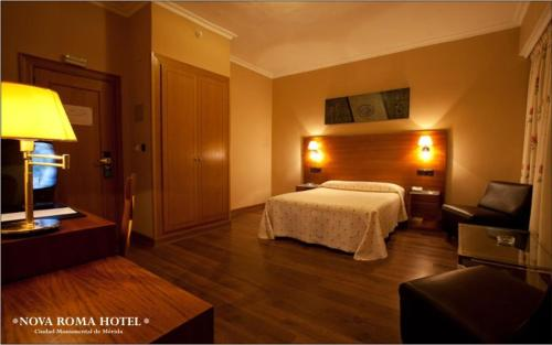A bed or beds in a room at Nova Roma