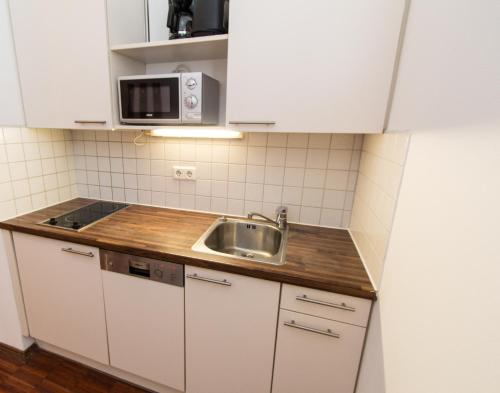 A kitchen or kitchenette at Premium Apartment
