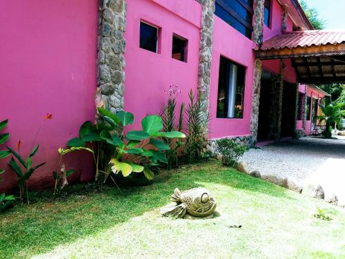 A garden outside Bali Suites Itamambuca